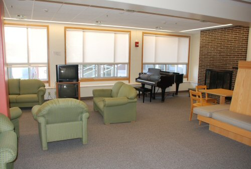 Comfortable Dorm Lounge area with TV and piano